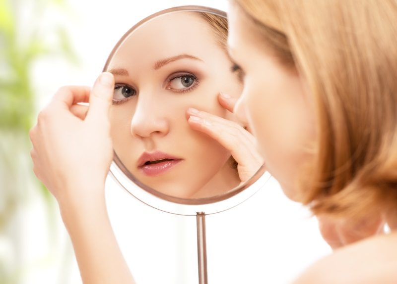 face-of-young-beautiful-healthy-woman-and-reflection-in-the-mirror