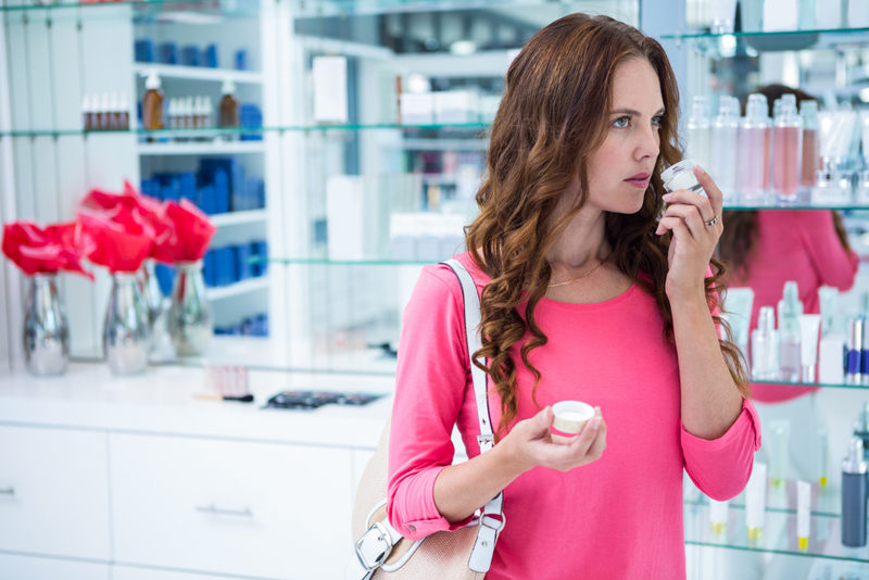 pretty-woman-shopping-for-cosmetics-at-the-pharmacy