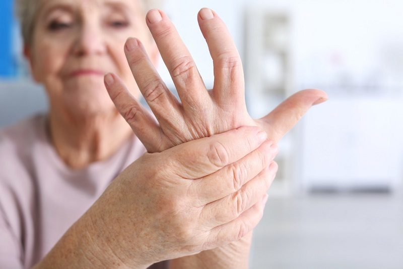 elderly-woman-suffering-from-pain-in-hand-closeup