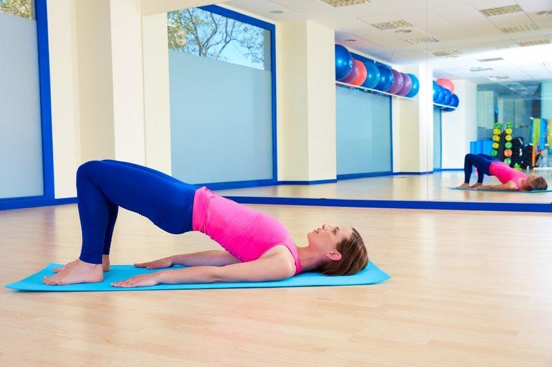 pilates-woman-shoulder-bridge-exercise-workout