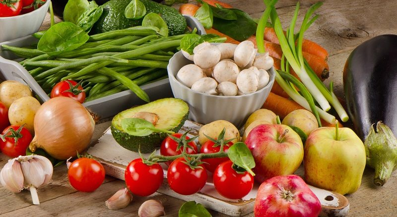 organic-vegetables-and-fruits-on-a-wooden-table