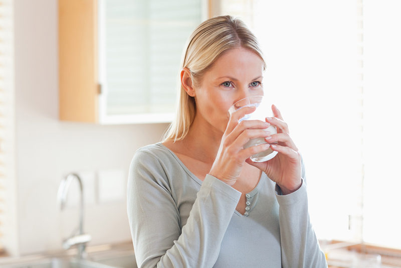 woman-in-the-kitchen-drinking-water-2