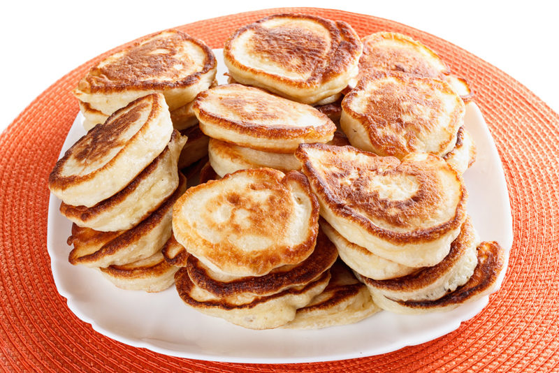 domestic-lush-pancakes-on-a-plate-isolated-white