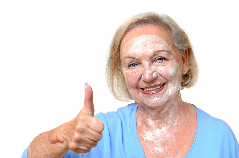 smiling-happy-elderly-woman-wearing-a-face-mask
