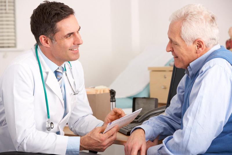 american-doctor-talking-to-senior-man-in-surgery