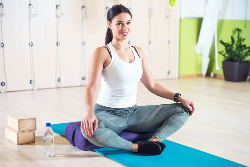 fit-woman-doing-stretching-pilates-exercises-in-fitness-studio
