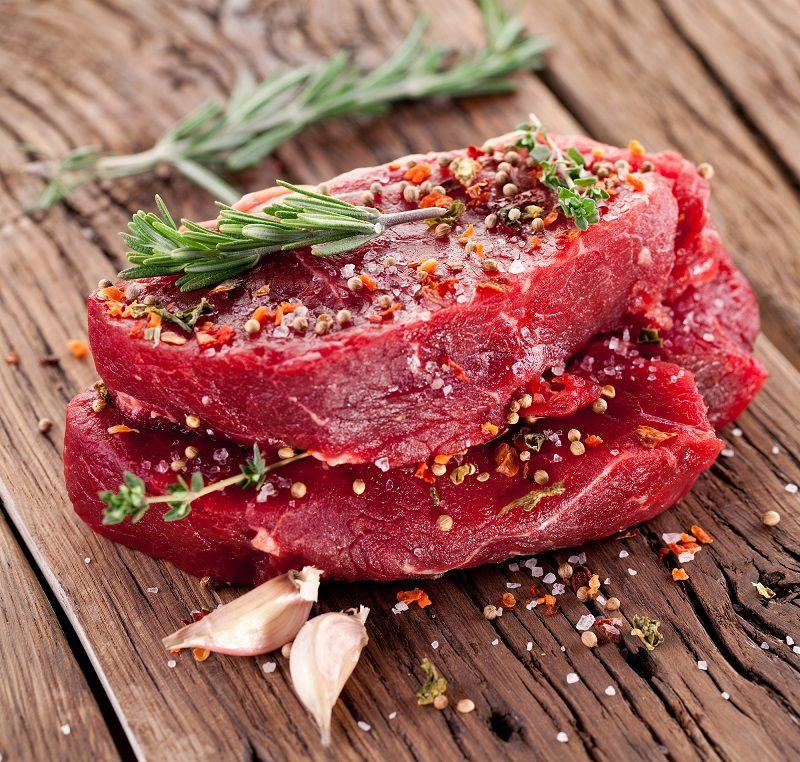 raw-beef-steak-on-a-dark-wooden-table
