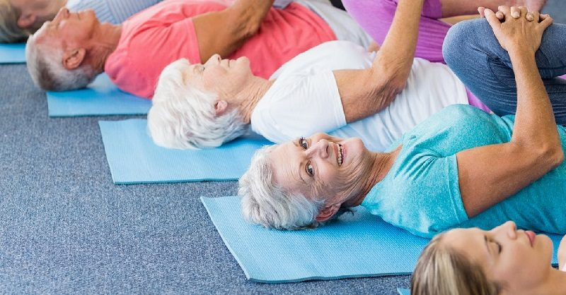 instructor-performing-yoga-with-seniors-2