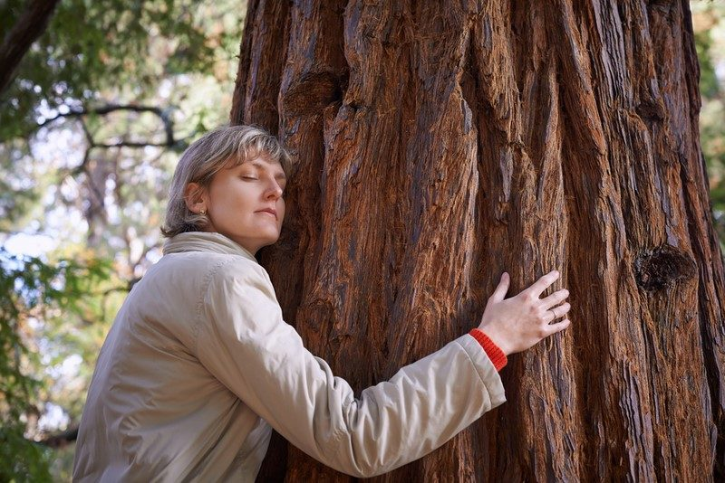 young-woman-hugging-a-tree-with-closed-eyes