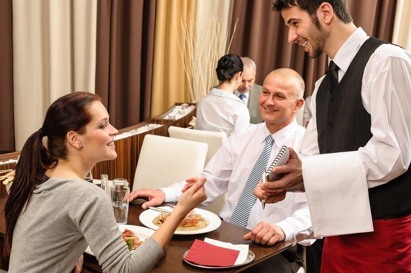 business-lunch-waiter-taking-order-at-restaurant