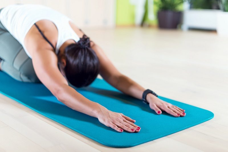 fit-woman-doing-stretching-pilates-exercises-in-fitness-studio-3