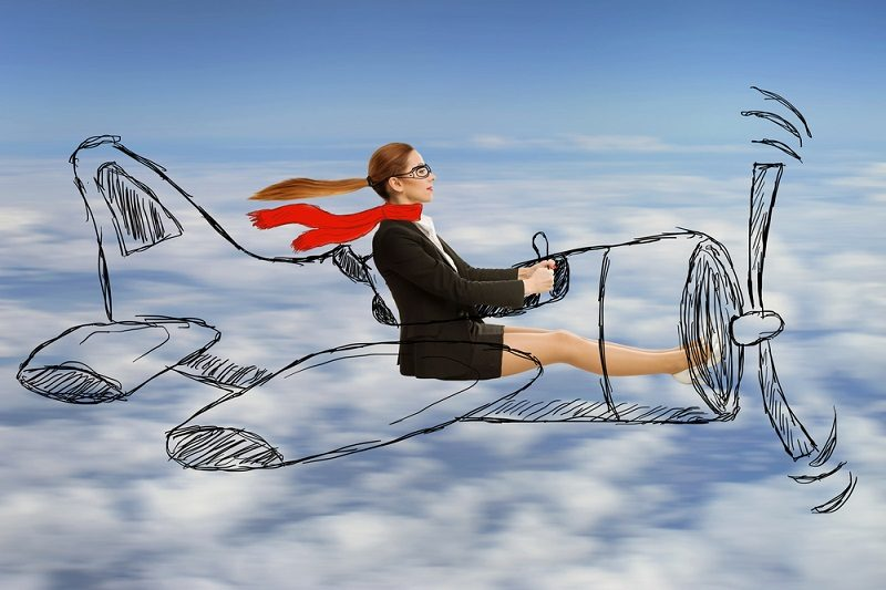 aviator-woman-with-scarf-and-glasses-flying-designed-airplane