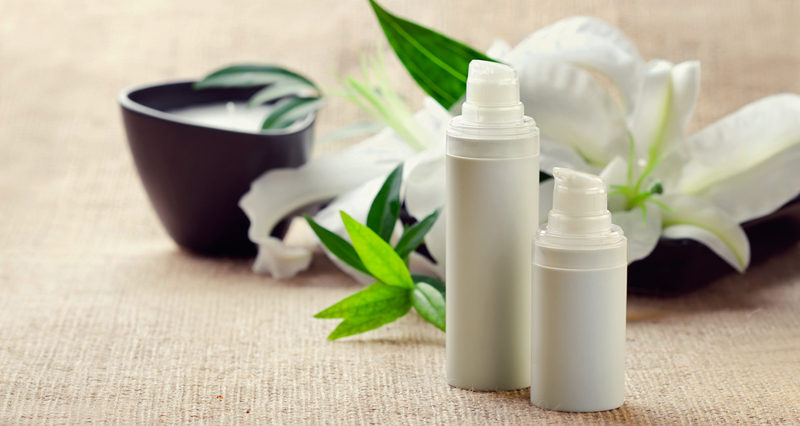 face-body-care-concept-bottles-of-creams-lotions-serums-with-wh