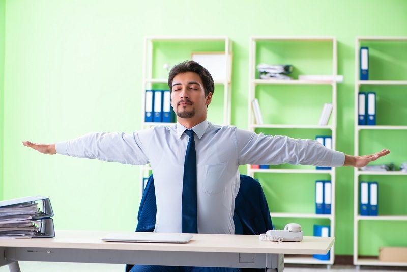 employee-doing-exercises-during-break-at-work