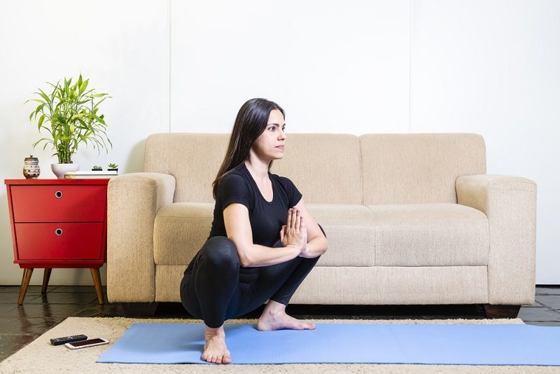 beautiful-caucasian-brunette-woman-in-black-clothes-on-blue-yoga