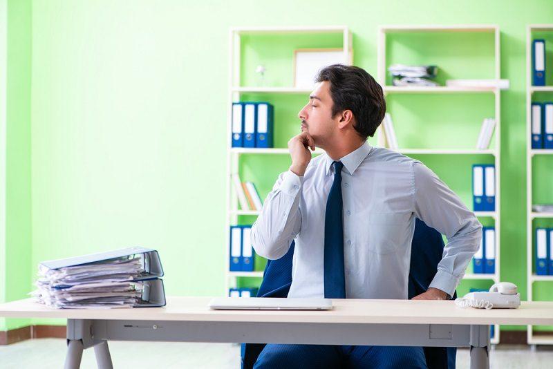 employee-doing-exercises-during-break-at-work-2