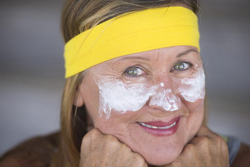 confident-mature-woman-facial-creme-portrait