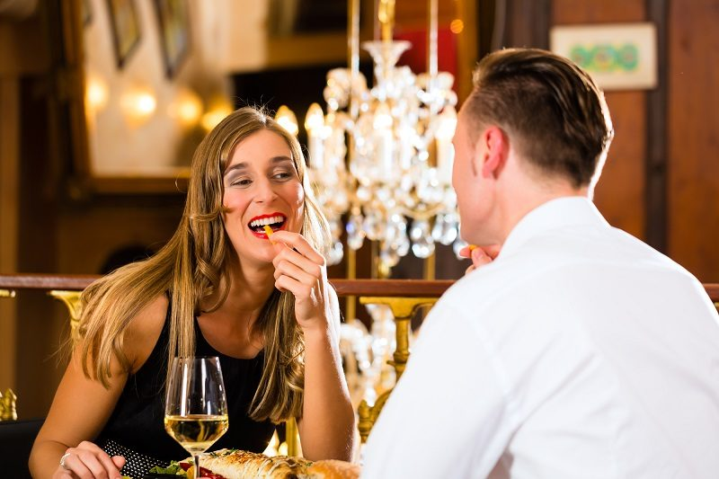 happy-couple-in-restaurant-eat-fast-food
