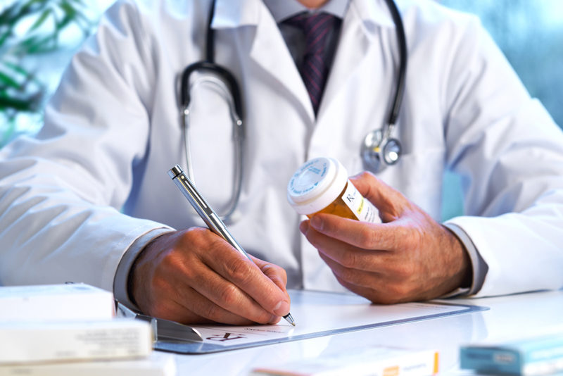 doctor-writing-out-rx-prescription