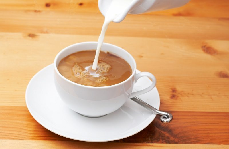 closeup-of-milk-being-poured-into-the-coffee
