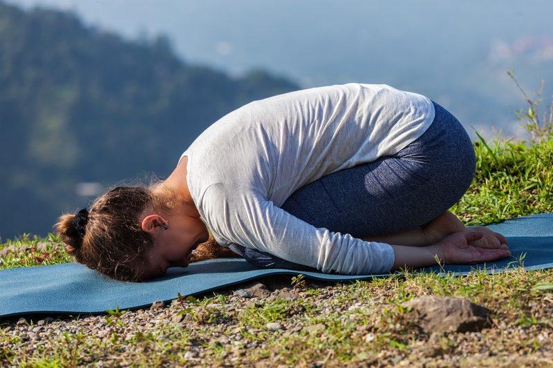 sporty-fit-woman-practices-yoga-asana-balasana